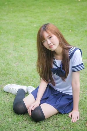 Foto de Portrait of thai teen beautiful girl in japanese student uniform happy and relax - Imagen libre de derechos