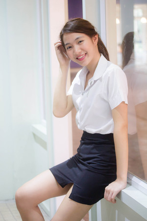 Photo for Portrait of thai adult student university uniform beautiful girl relax and smile - Royalty Free Image