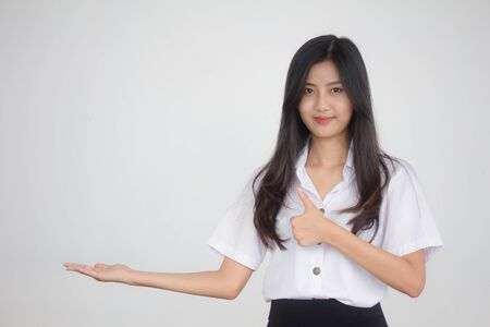 Photo pour Portrait of thai adult student university uniform beautiful girl show hand - image libre de droit