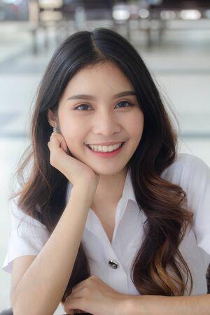 Photo pour Portrait of thai adult student university uniform beautiful girl relax and smile - image libre de droit