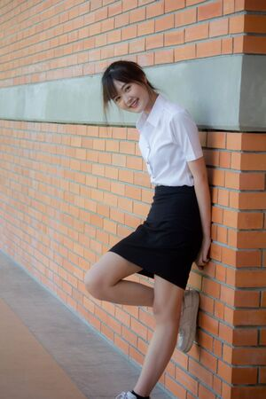 Photo pour Portrait of thai adult student university uniform beautiful girl relax and smile - image libre de droit