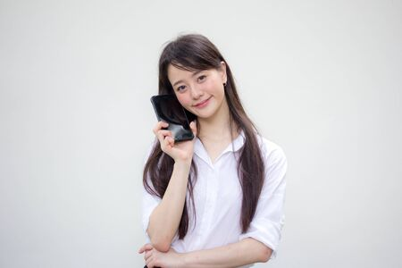 Photo pour portrait of thai china adult office girl white shirt show her smart phone - image libre de droit