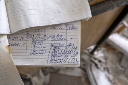 Photo for Chernobyl pripyat abandoned old notebook sheets written covered in dust - Royalty Free Image