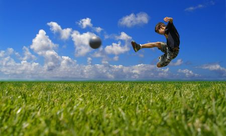Photo for Boy playing soccer against the sky - Royalty Free Image