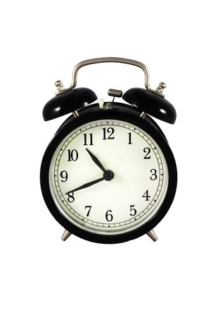 Black old alarm clock - isolated in white background
