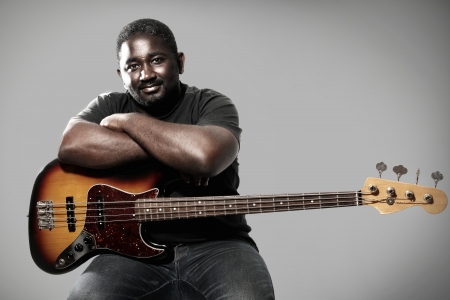 an american african bass player on white background
