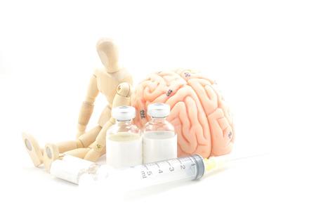diagnosis of human brain and wooden human model