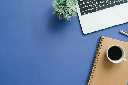 Photo pour Minimal work space - Creative flat lay photo of workspace desk. Top view office desk with laptop, notebooks and coffee cup on blue color background. Top view with copy space, flat lay photography. - image libre de droit
