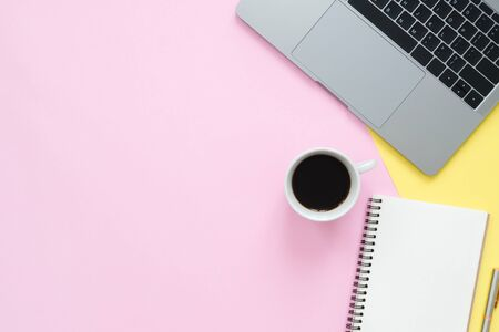 Photo pour Creative flat lay photo of workspace desk. Top view office desk with laptop, blank empty notebooks and coffee cup on pastel color background. Top view with copy space, flat lay photography. - image libre de droit