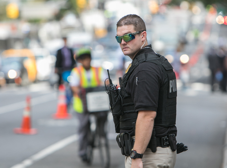 Photo for A Secret Service agent is helping direct traffic and keeping the reserved lane on the 2nd Avenue clear during the UN General Assembly. - Royalty Free Image