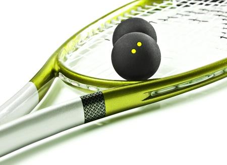 Green and silver squash racket and balls