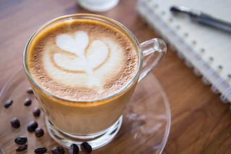 Tulip latte art coffee on wooden background
