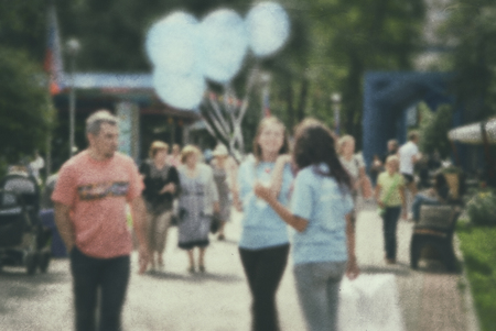 Blurred background people. Active lifestyle in the park- recreation and entertainment.