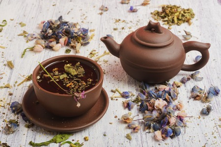 Herbal and floral tea. Still life- cup and kettle. It is possible to print large format.