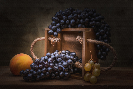 Natural still life with grapes in vintage tin vase. Interior decoration - photo print large format.