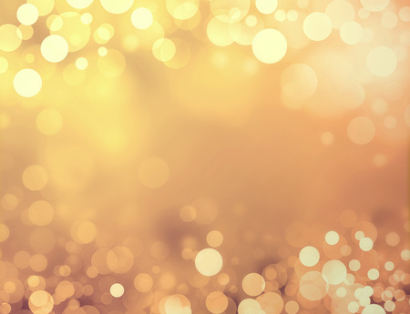 Shiny gold background with blurry circles and sparklesの写真素材
