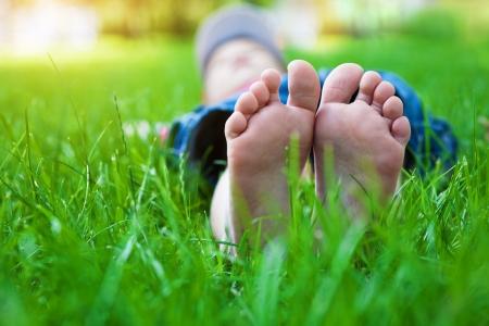 feet on grass  Family picnic in spring park