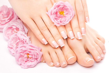 Photo for pedicure and manicure with a pink rose flower - Royalty Free Image