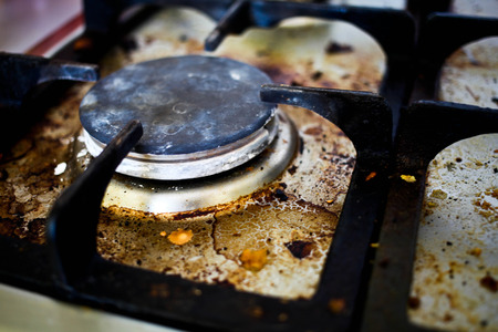Photo pour Burner of old dirty gas cooker. - image libre de droit
