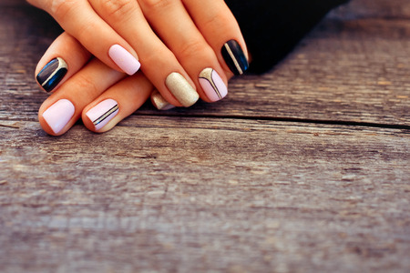 Foto de Natural nails, gel polish. Perfect clean manicure with zero cuticle. Nail art design for the fashion style. - Imagen libre de derechos