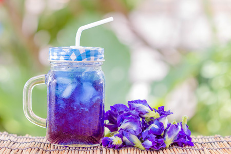 Juice of Butterfly pea with ice in pitcherの写真素材