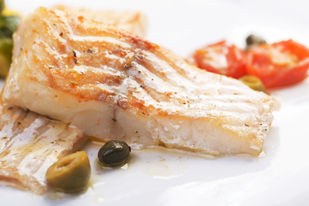 Cod fillets with olives and capers / Mediterranean cuisine