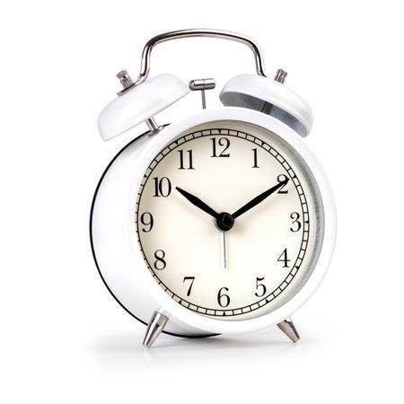 Foto de Classic white alarm clock isolated on white background - Imagen libre de derechos