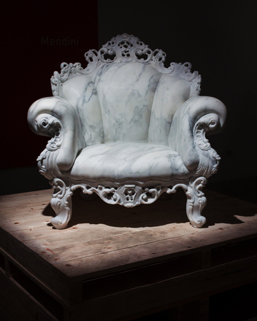 MILAN, ITALY - APRIL 11: Mendini's marble armchair on display for Fuorisalone at Ventura Lambrate space, location of important events during Milan Design week on APRIL 11, 2014 in Milan