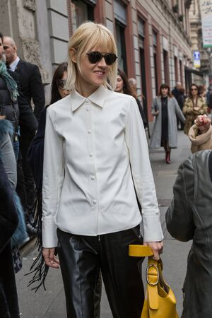 MILAN, ITALY - FEBRUARY 26: Fashionable woman outside Sportmax fashion show during Milan Women's Fashion Week on FEBRUARY 26, 2016 in Milan.
