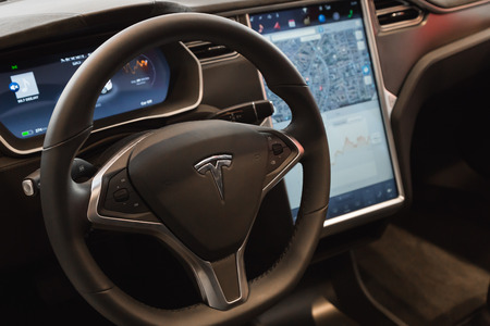 MILAN, ITALY - MARCH 31, 2016: Interior of Tesla Model S 90D car. Tesla Motors  is an American company that designs, manufactures, and sells cutting edge electric cars.