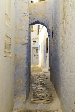 Narrow alley with a archways in the medina of Hammamet in Tunisia