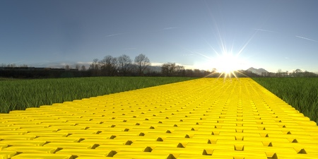 Gold brick road on grass with sun and blue sky