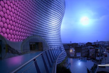 bullring building and view of birmingham at night by moon light. famous english architecture