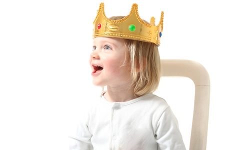 child king with crown isolated on white. Happy toddler with royal head gear smiling having fun