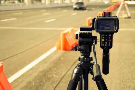 catch speeding drivers with a radar gun, vintage color style