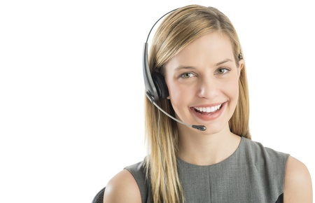 Close-up portrait of confident female customer service representative wearing headset isolated over white background