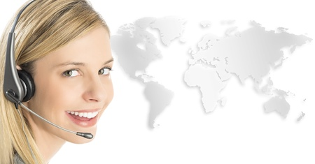 Close-up portrait of female customer service representative wearing headset with world map against white background