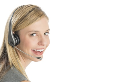 Close-up portrait of happy female customer service representative wearing headset isolated over white background