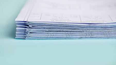 Photo for Stack Folding drawings on a blue background. Copy space. - Royalty Free Image