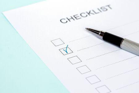 Photo pour Close-up of on Checklist with pen on a blue background. - image libre de droit