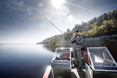 Men is fishing on the bass boat