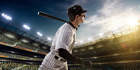 Professional baseball player in action on grand arenaの写真素材
