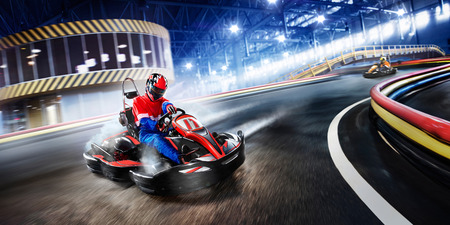 Photo pour Two cart racers are racing on the grand track motion - image libre de droit