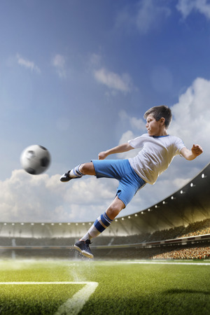 Photo pour Childrens are playing soccer on grand arena in sunlights - image libre de droit