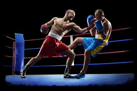 Foto de professional boxers are isolated on black background dark - Imagen libre de derechos