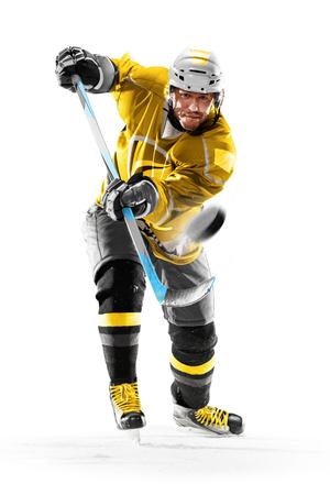 Foto de Professional ice hockey player in action on white backgound - Imagen libre de derechos