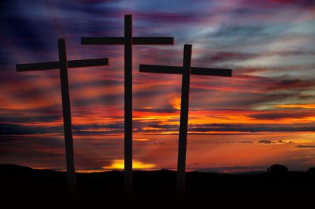Three Christian Crosses Silhouetted Against Dramatic Radiant Red Sunset