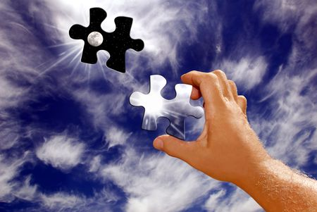 Photo pour Hand Holding Sun and Moon Puzzle Piece Leaving Hole in the Sky - image libre de droit