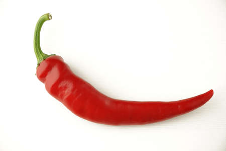 Foto für beautiful ripe big red hot chili pepper with a green tail on a white background - Lizenzfreies Bild