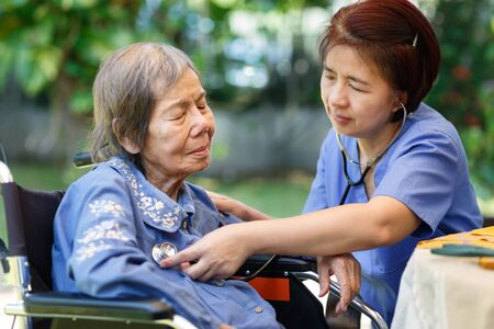Photo for nurse checking lung of elderly woman during homecare medical - Royalty Free Image